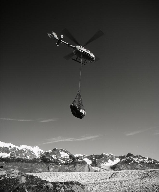 Helicopter pilot Jim Harvey (Air Logistics) moving sling loads at Columbia Glacier, June 2004