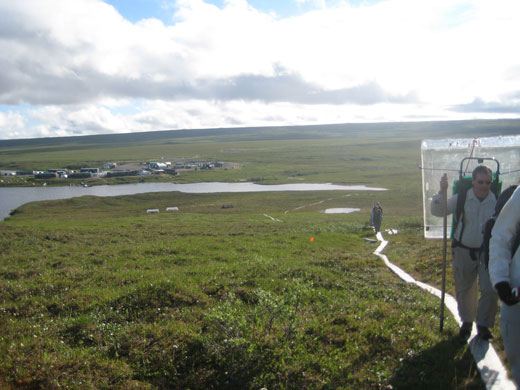 Scientists hike boardwalk to their tundra plots. Toolik Field Station lies below. Photo: Christine Dell'Amore, 2008 MBL Science Journalism Fellow