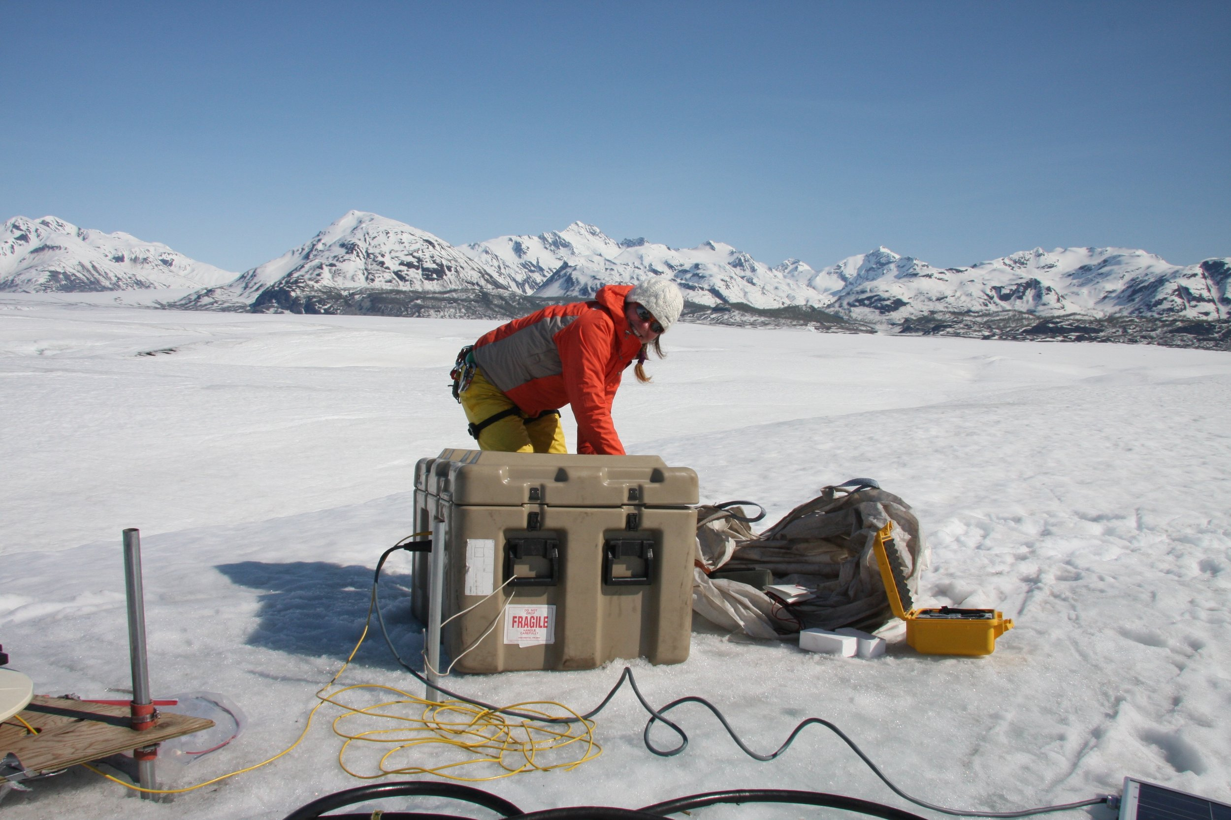 Team member Barbara Truessel sets up one continuous GPS unit in May