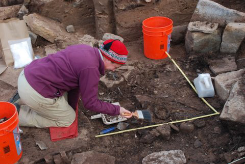 Genevieve LeMoine excavating baleen artifacts in the floor of a Thule house on Cape Grinnell. Photo by Christyann Darwent