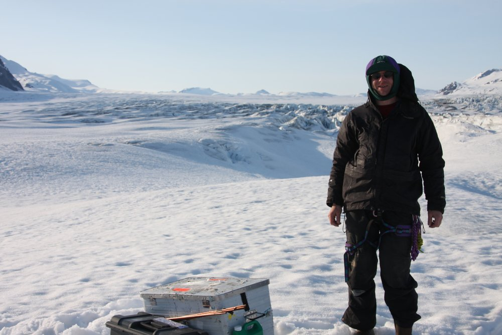 Martin Truffer drills into the glacier to install monitoring equipment.