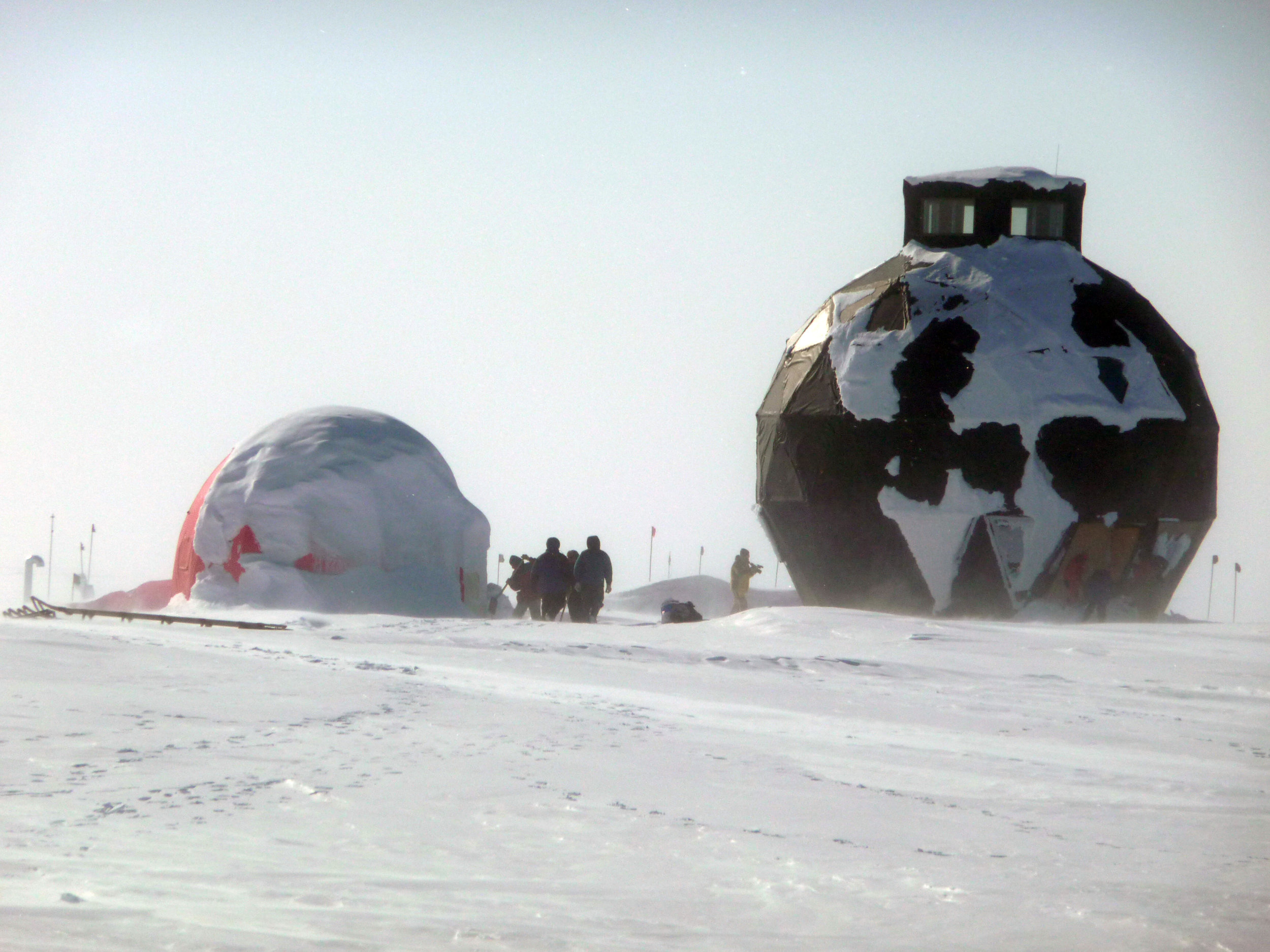 NEEM's iconic black dome. Inside the three-story structure: kitchen, bathroom, dining area, lounge, some sleeping quarters, and, at the top, the field master's roost, wherein most communications work is conducted. Photo: NEEM ice core drilling project, www.neem.ku.dk.