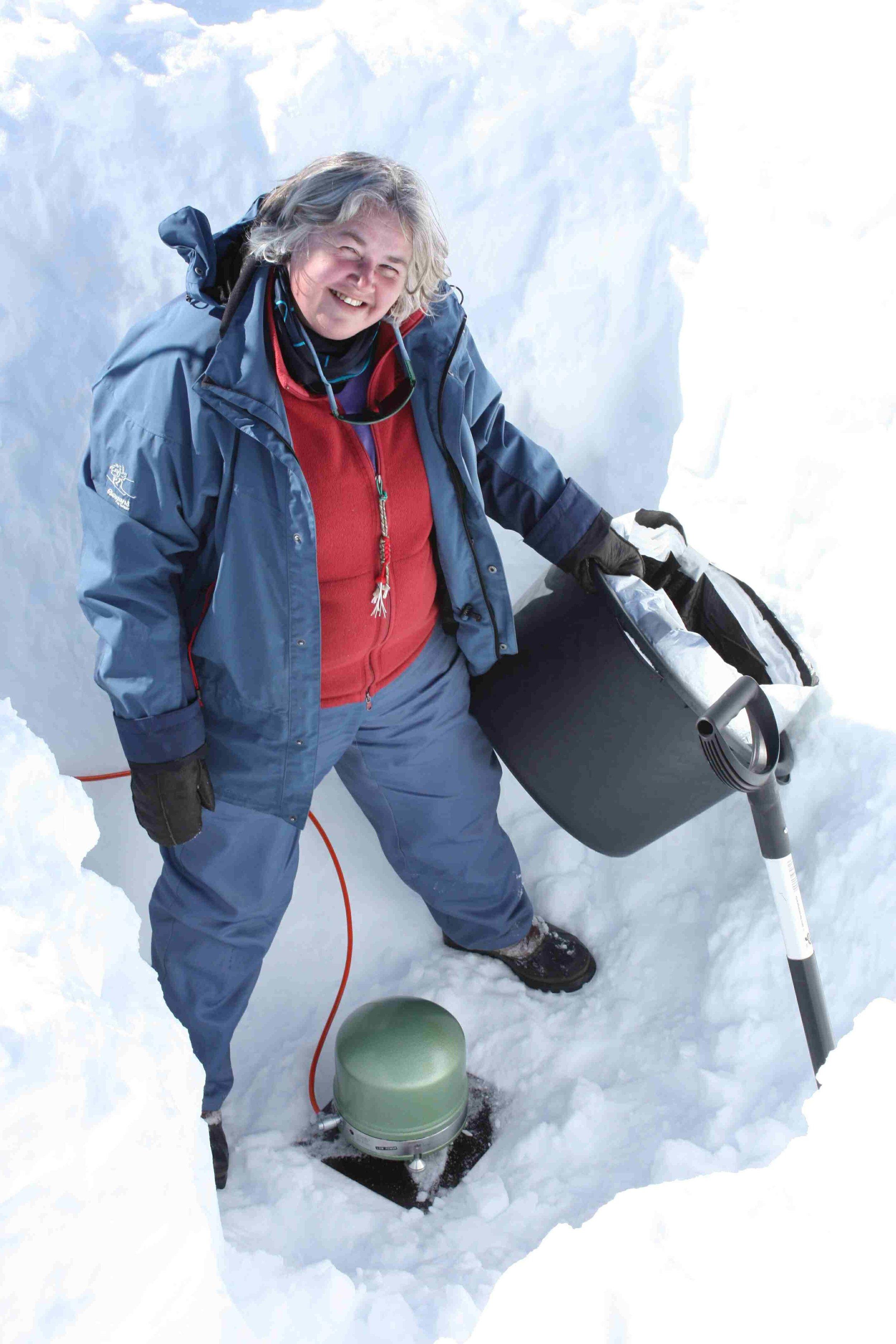PI Trine Dahl-Jensen installing a seismometer, seen here at her feet.