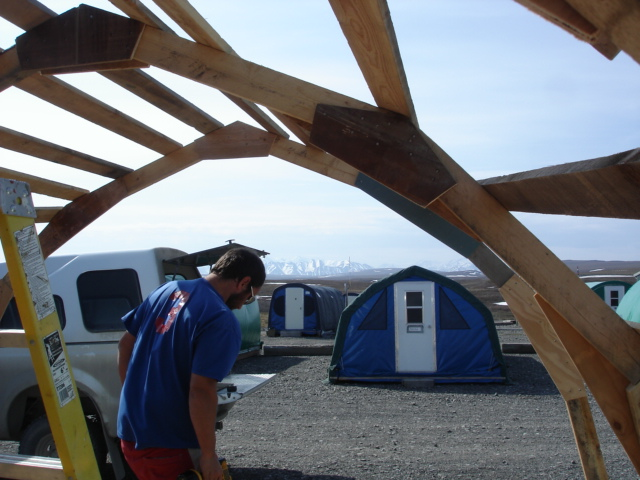 Many of the approximately 125 visitors to Toolik this summer will sleep in Weatherport tents set on wooden platforms. Here, Matt Cekosh repairs one of tents. Photo:  Jason Neely