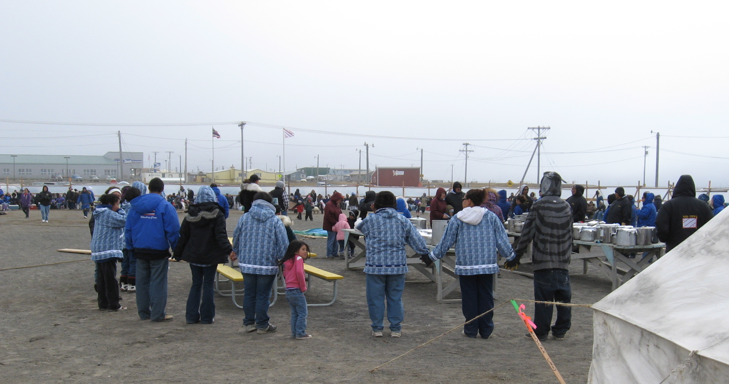 This photo, from Fairbanks Open Radio, documents Barrow's June Nalukataq. The two whaling crews who brought in the whales fly their flags, center, and the community gives thanks for the harvest. Later, everyone enjoys the blanket toss and dancing in the gym. Photo: David Koester