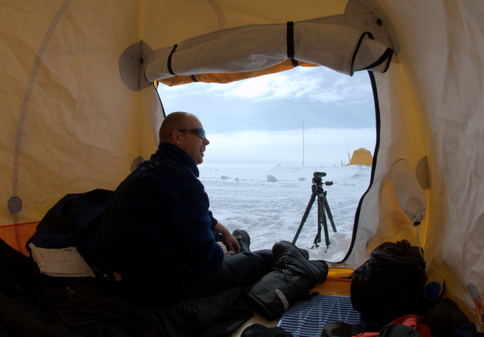"""""""Room"""" with a view: Bo Gregersen of the US Embassy in Copenhagen monitors the ice cap from his tent. Photos: Henning Thing unless otherwise noted"""
