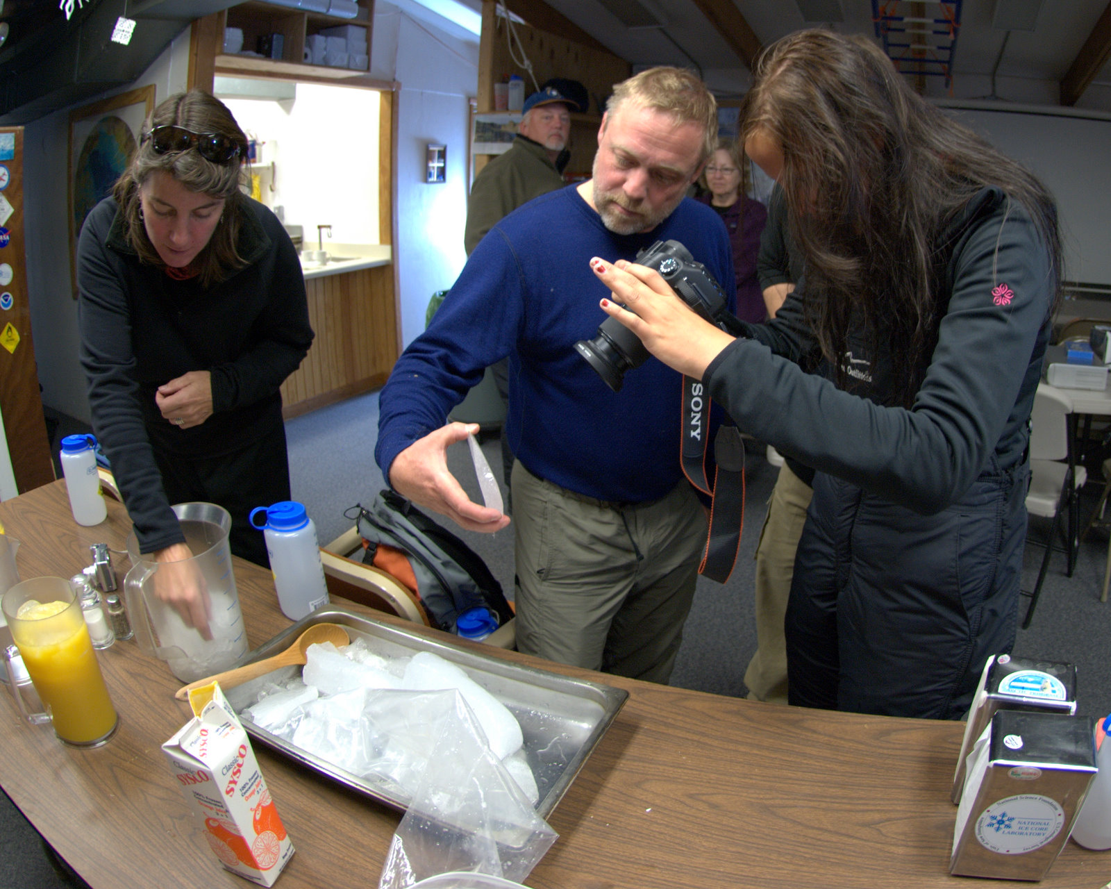 To learn about ice-core science, the group examined bits of discarded ice core to see the bubbles that contain tiny packets of air from days gone by; they also floated bits of core in orange juice to experience the pop and fizz of the compressed air being released from the melting ice.