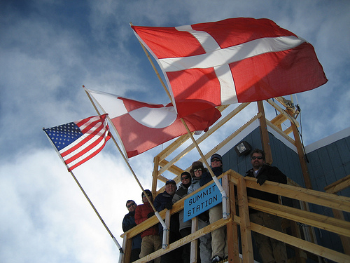 Flags for the United States, Greenland, and Denmark fly at Summit Station for Science Education Week. Photo: Angela Coyle