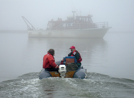 WHOI researcher Phil Alatalo motors out to the Annika Marie, a small research vessel chartered for the zooplankton study led by Carin Ashjian. This picture courtesy of Wood's Hole Image of the Day.