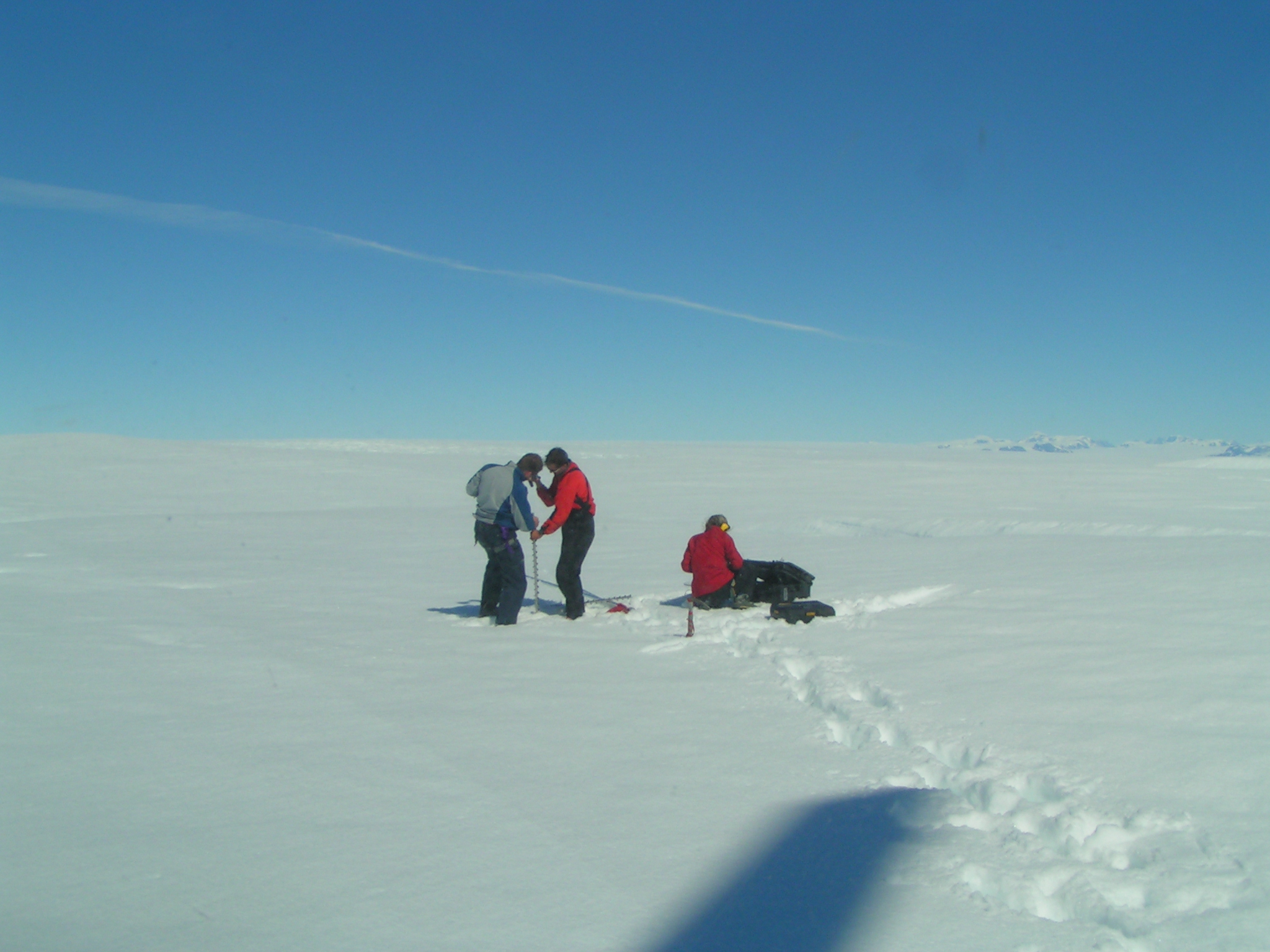 Here researchers install a GPS instrument in the middle of nowhere--actually a northern section of the Helheim). Photo: J. Vilendal Petersen