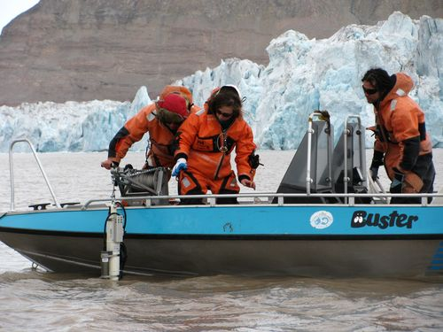 On Norway's Svalbard archipelago, teacher Mike Rhinard participates in a research experience for undergraduates field course studying high Arctic change. Here, the group prepares to lower a CTD sensor into the water.