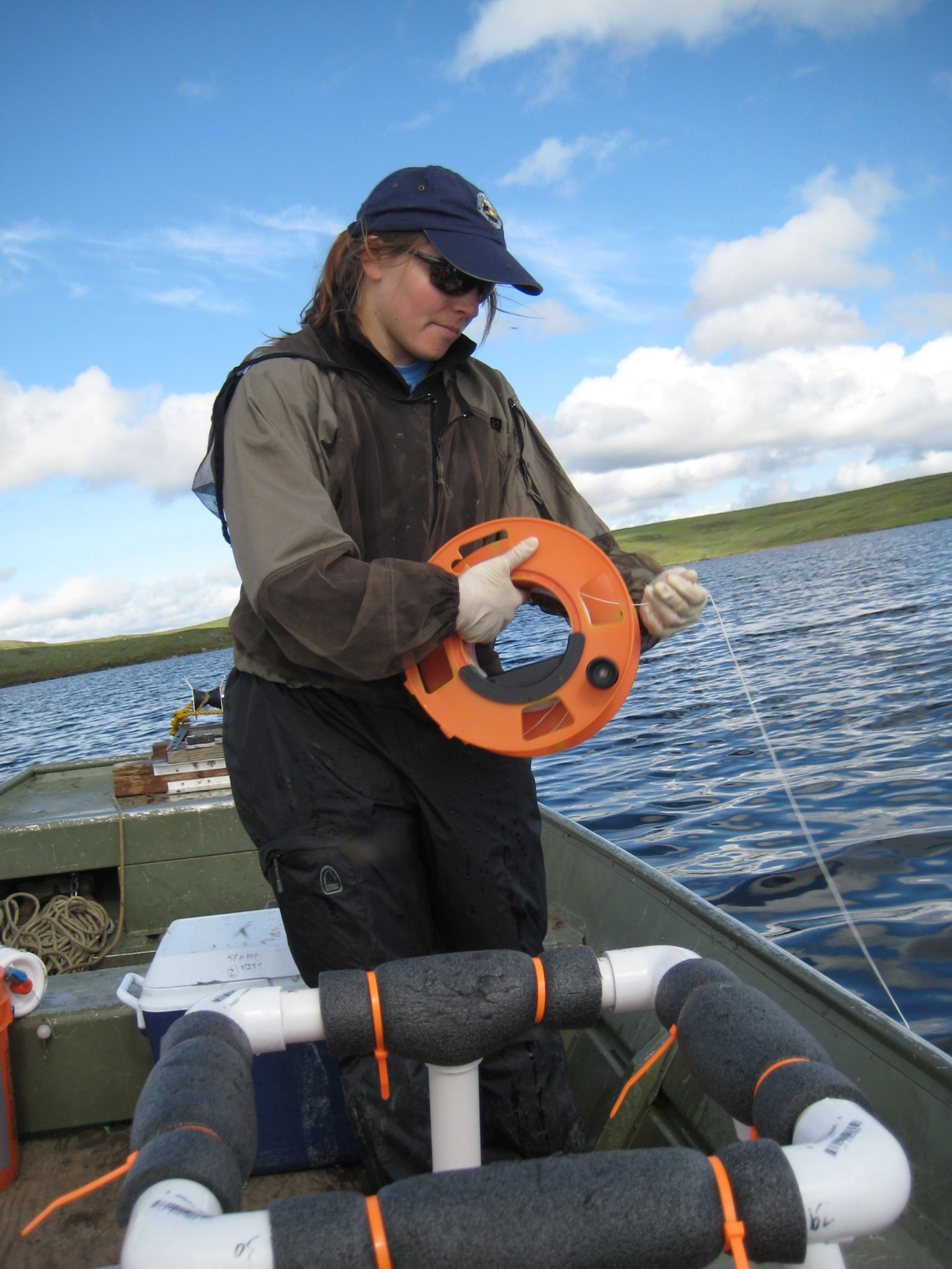 Megan Melack helps her mother, Sally MacIntyre, deploy instruments in Toolik Lake that read the temperature and turbulence of the water below the surface.