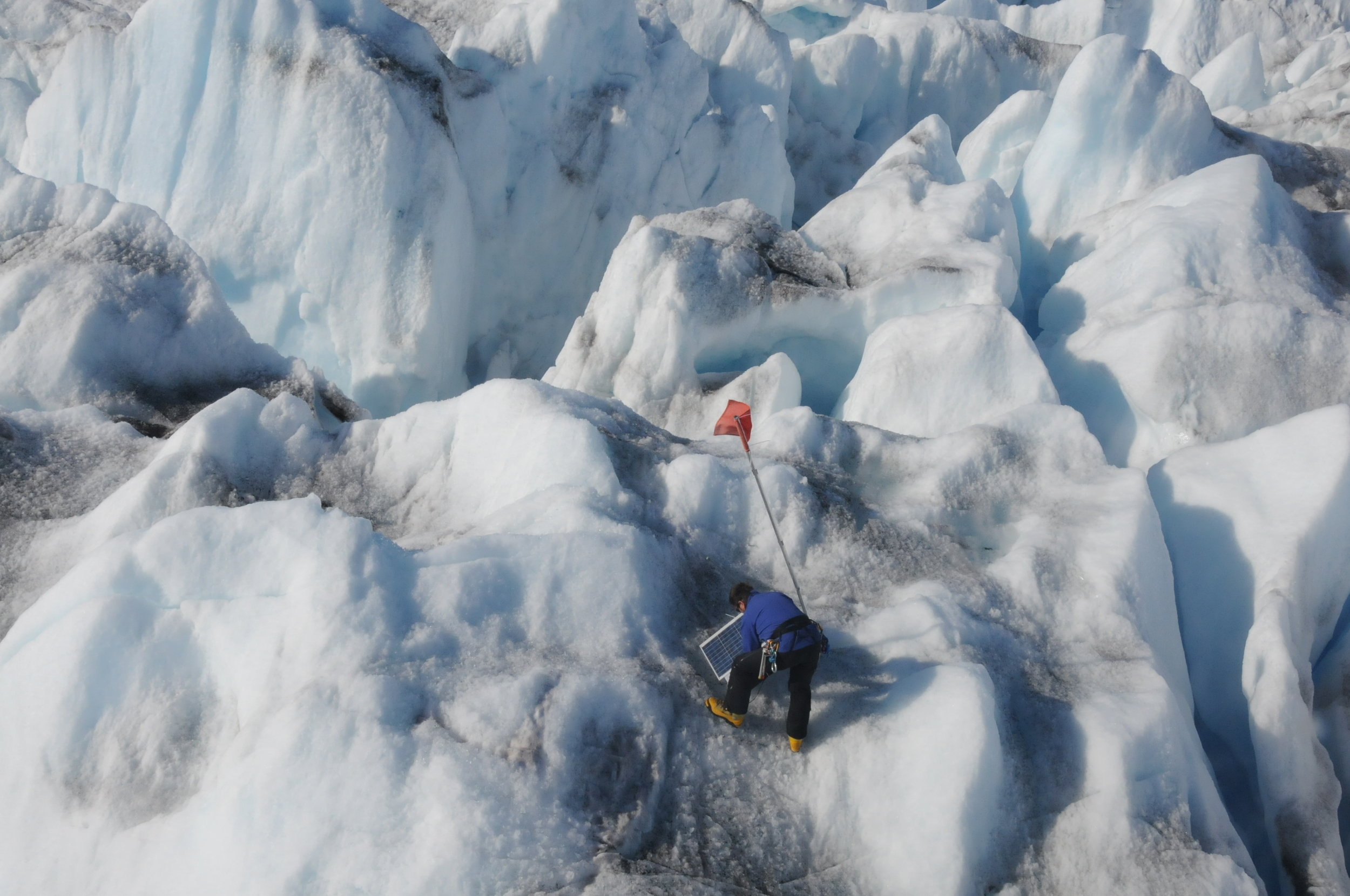 Gordon Hamilton (PI from University of Maine) recovers a GPS instrument from Helheim Glacier during summer 2009 field work. Photo: Leigh Stearns