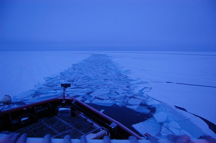 The ship leaves a wake of broken ice. Photo courtesy USCGC Polar Sea.