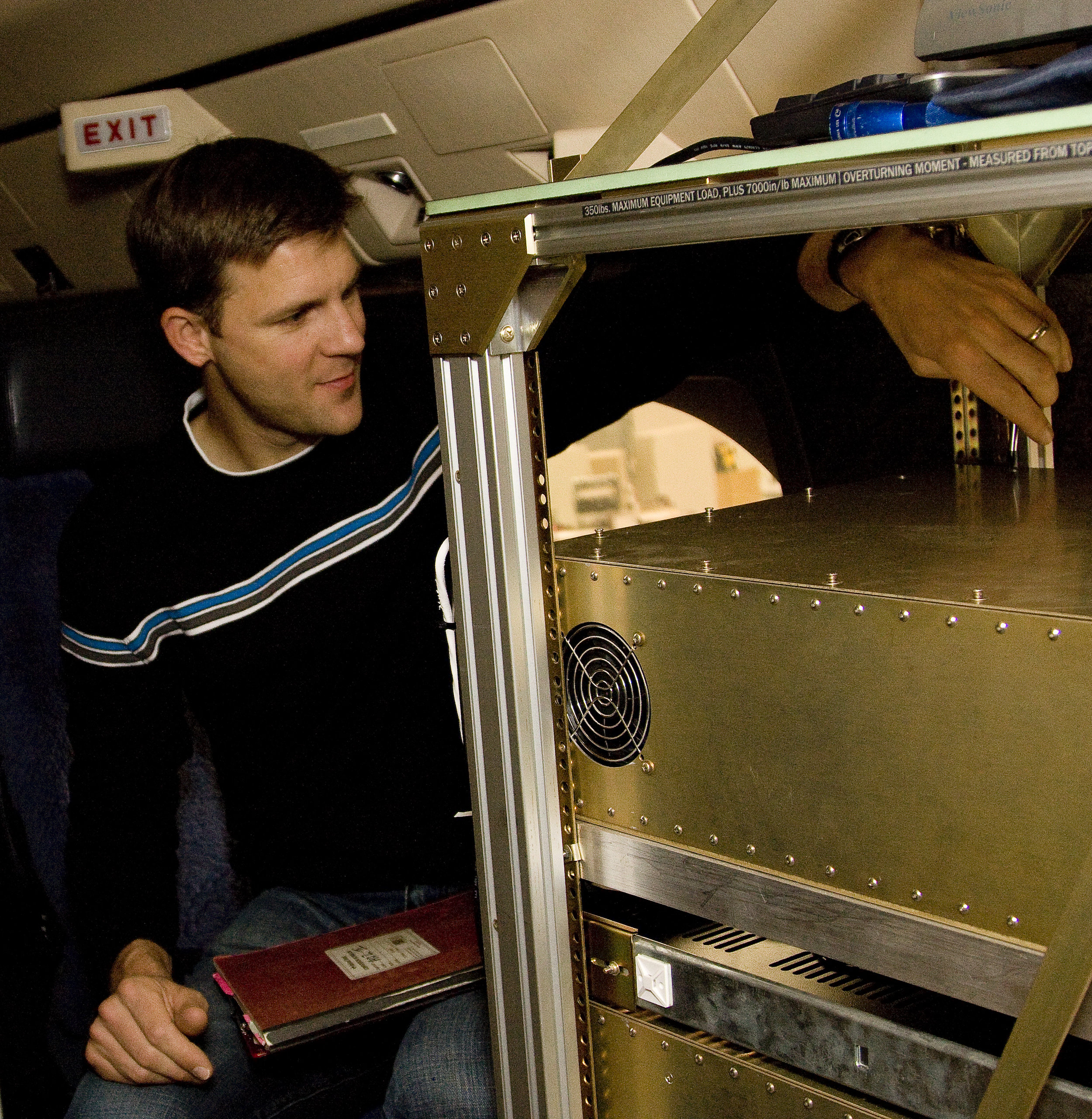 National Center For Atmospheric Research co-PI Britt Stevens adjusts equipment aboard the Gulfstream V. Photo: Courtesy UCAR