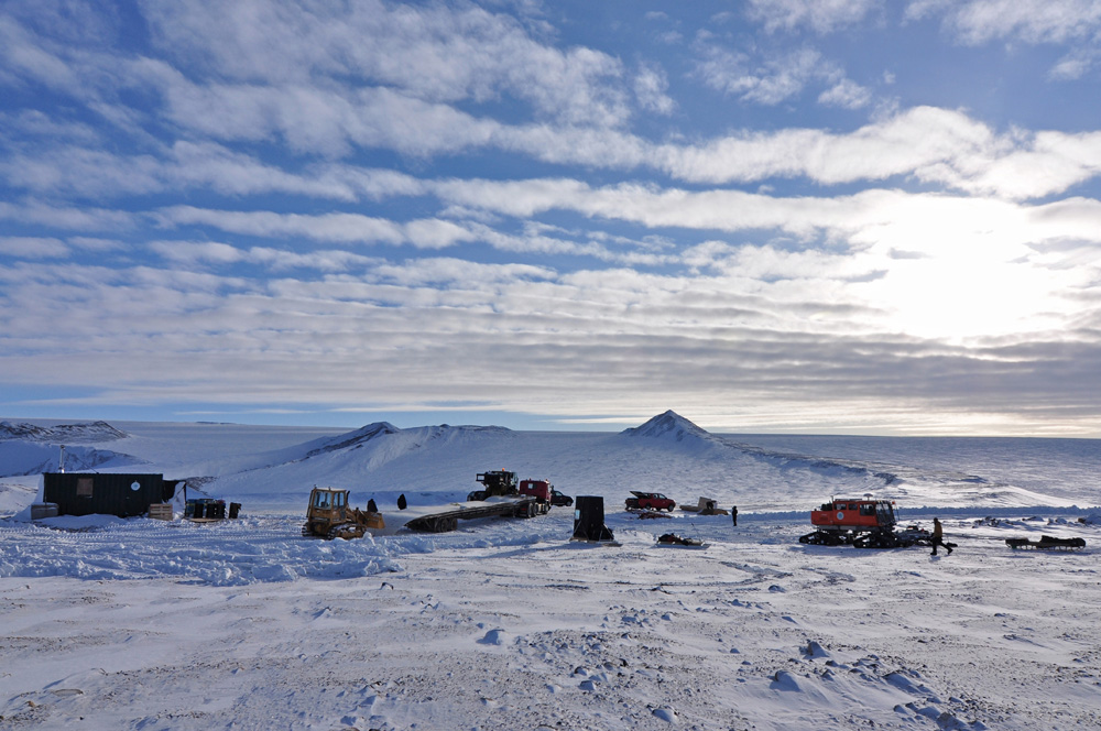 Unloading the first of two 60-ft sleds to be used for mobility tests. Looking south to the icecap, the pointed hill on the skyline is the ramp. Photo: Robin Davies