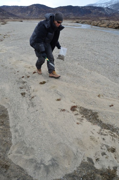 Jeremy Shakun collects sand.