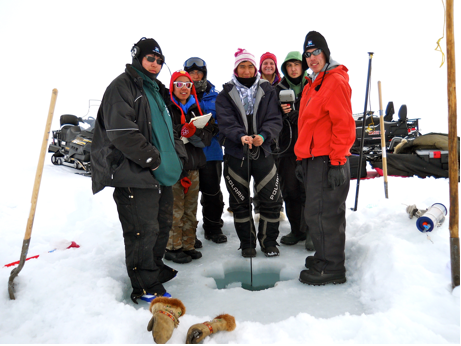 The members of the Student Sampling Program deploy a YSI datasonde at their sampling site in Kaktovik Lagoon.