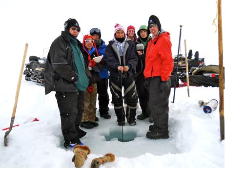 The members of the Student Sampling Program deploy a YSI datasonde at their sampling site in Kaktovik Lagoon.