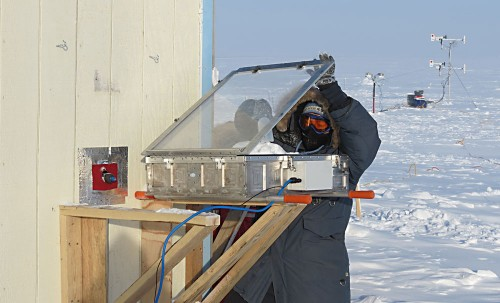 Kerri Pratt, a National Science Foundation postdoctoral fellow, conducts a snow-chamber experiment in minus 44 degree Fahrenheit windchill near Barrow, Alaska.Photo: Paul Shepson, Purdue University