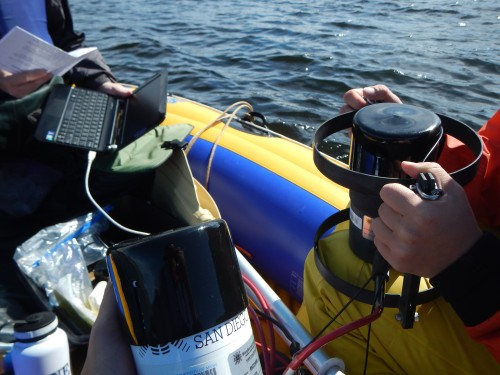Tools of the trade—the researchers prepare to deploy light sensors that measure how light disappears down the water column.