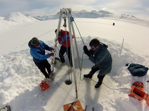 A busy day in the field this spring. Scientists core for sediments they will use to reconstruct the Arctic's past in the Brooks Range in northern Alaska. Photo: Jason Briner