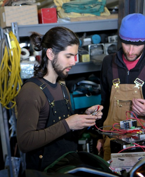 Gabriel Trisca (left) and Mark Robertson, graduate students at Boise State University, repair connectors on the motor controller for GROVER. June 1, 2013.