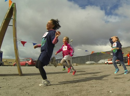 Kids celebrate at the finish line of the second annual Running of the Moskus foot race in Kangerlussuaq. Photo: courtesy Naomi Whitty