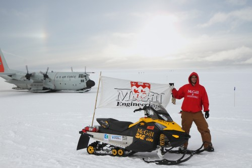 Engineering undergrad Ali Najmabadi poses with his team's electric snowmachine in front of the Big House at Summit Station, Greenland. Photo:  McGill University Electric Snowmobile Team