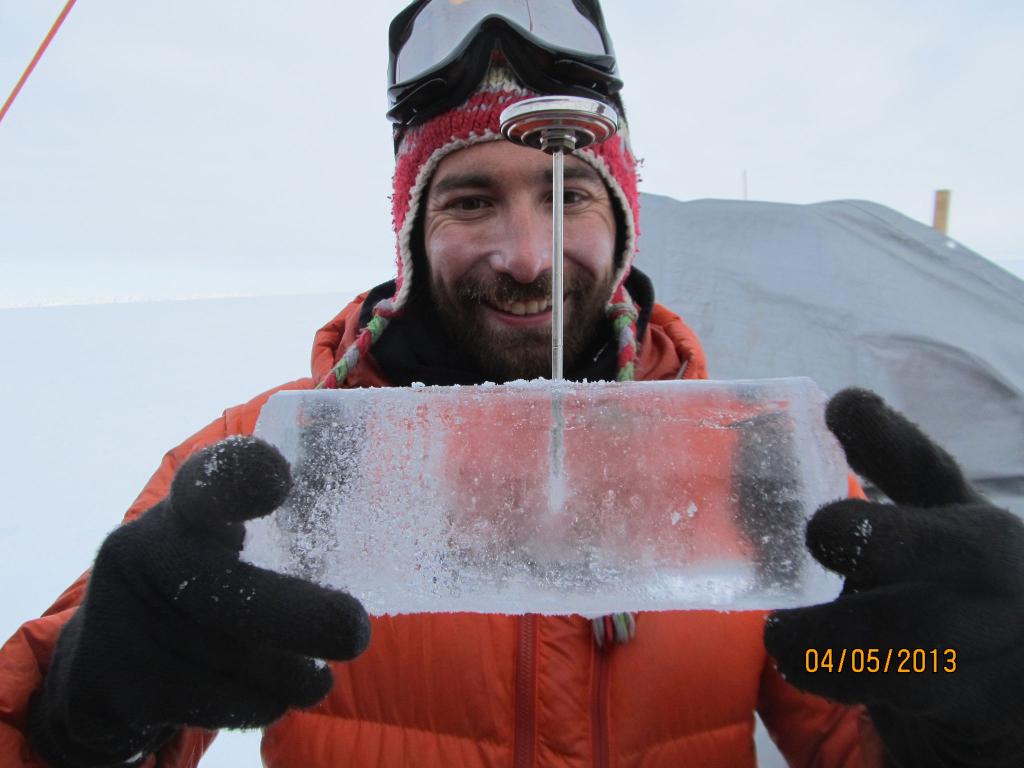 Clément Miège exhibits some very wet ice core harvested from the Greenland Ice Sheet in early spring, 2013. Miège is part of the team led by Rick Forster (University of Utah) investigating a perennial aquifer in the Greenland Ice Sheet - a team PFS supports. Photo: Jay Kyne (IDDO)