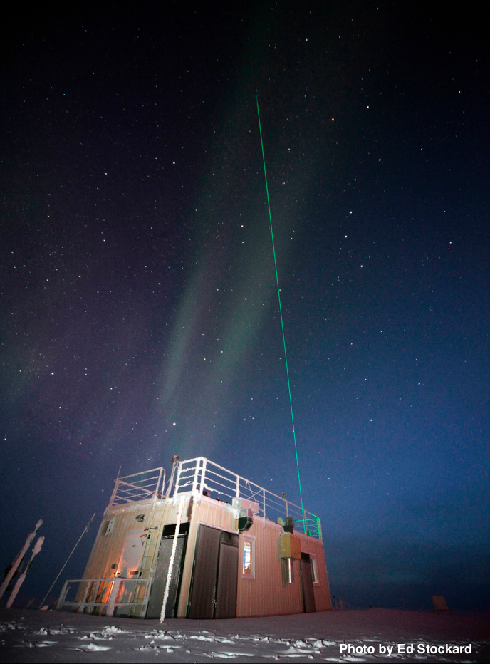 Green LiDAR beam emanating from the Mobile Science Facility. Photo: Ed Stockard