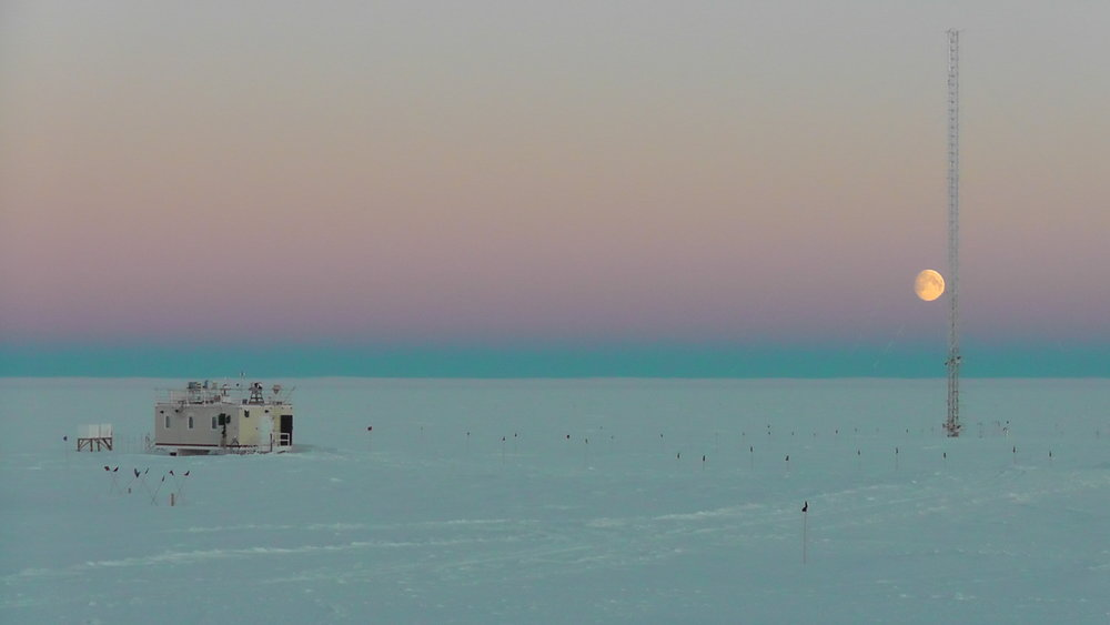 Moon rise at Summit Station, Greenland (including the Mobile Science Facility and the Swiss Tower). Photo: David Benson