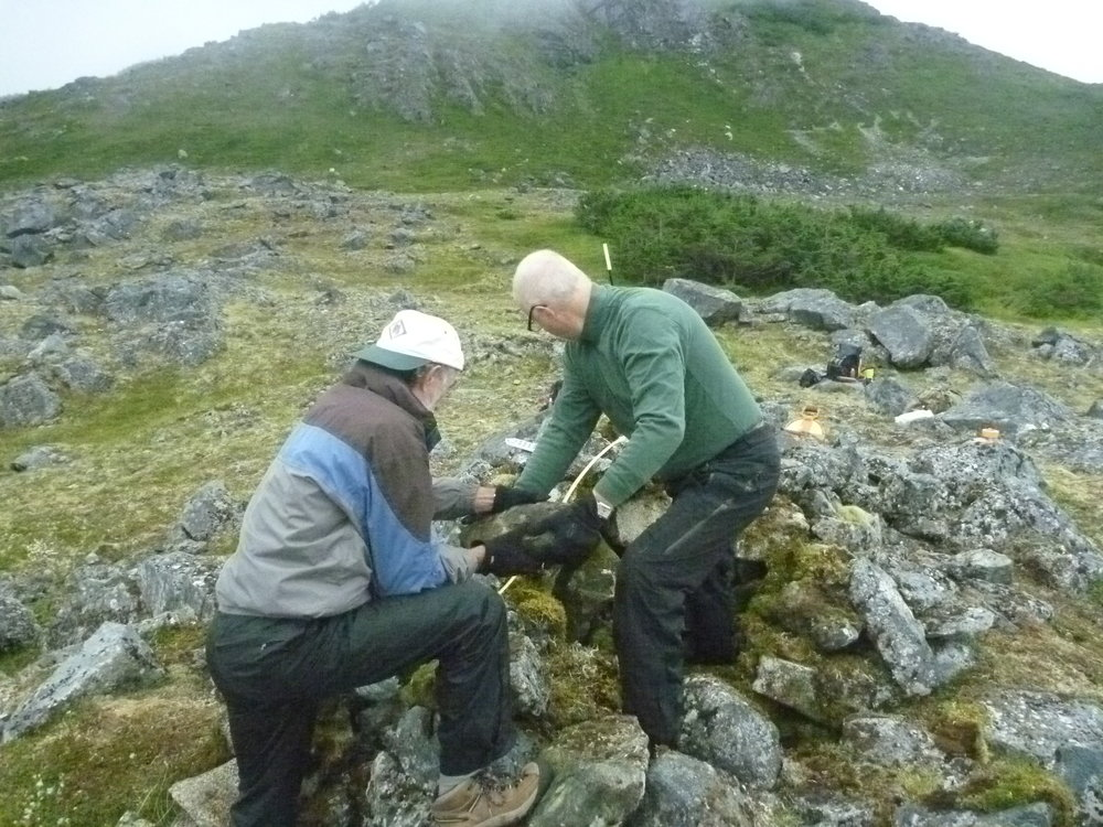 Drs. Ralph Hartley (left) and William Hunt exploring one of the cairns. All photos courtesy William Hunt.