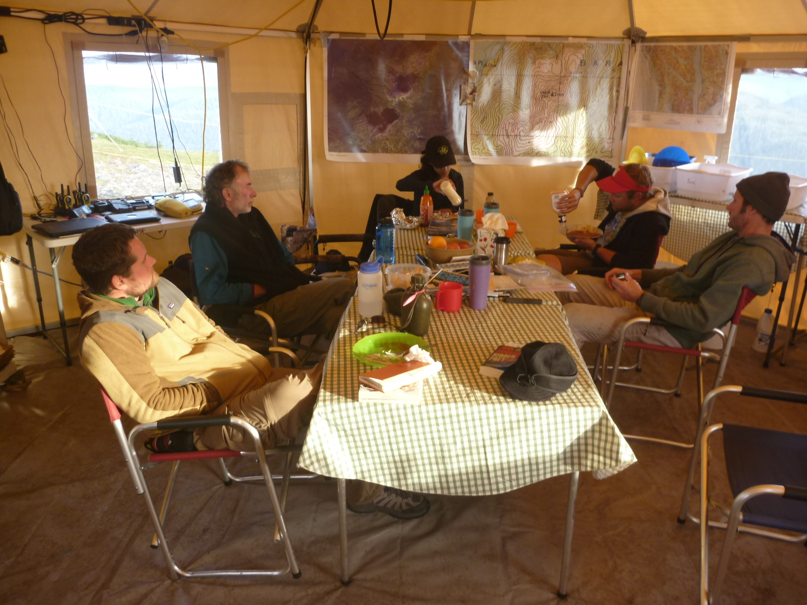 Some of the field team relaxing in the dining\laboratory tent. From left to right: Mike Chodornek (UN-L), Dr. Ralph Hartley (UN-L), Pete Stegen (NET), Nijmah Ali (OSU), and Dean Einerson (PFS Camp Manager).