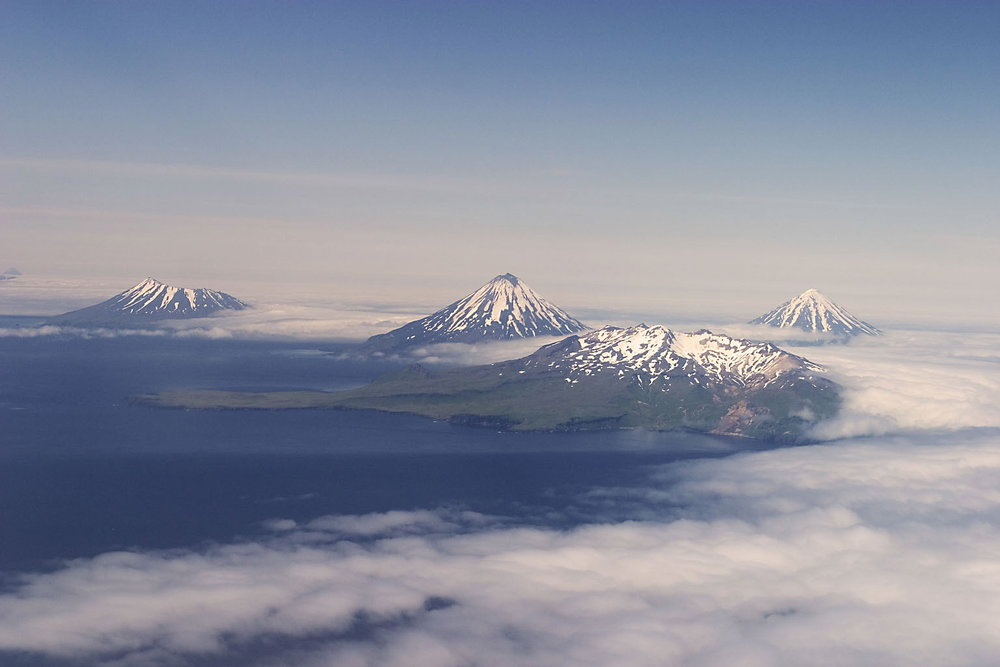 "An aerial photo of the Islands of the Four Mountains. Photo: Ken Wilson, author of ""The Aleutian Islands of AK: Living on the Edge"""