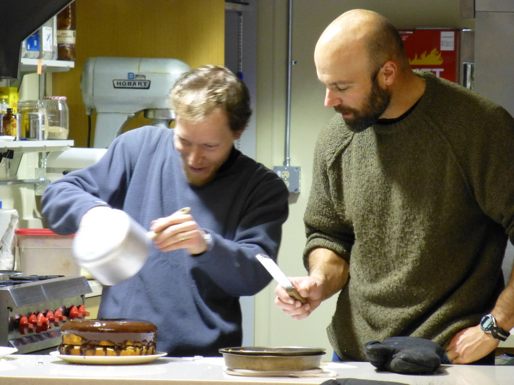 At left, Jacques Hueber (grantee) and Ken Keenan (Phase I Site Supervisor) putting the finishing touches on Alia's birthday cake. Photo: Tracy Sheeley