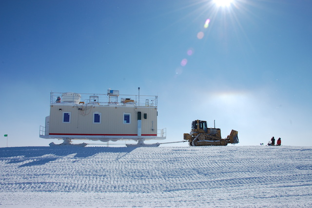 The MSF at rest in its new position. Note the halo above the dozer formed by ice crystals (part of the ICECAPS study). Photo: Von Walden