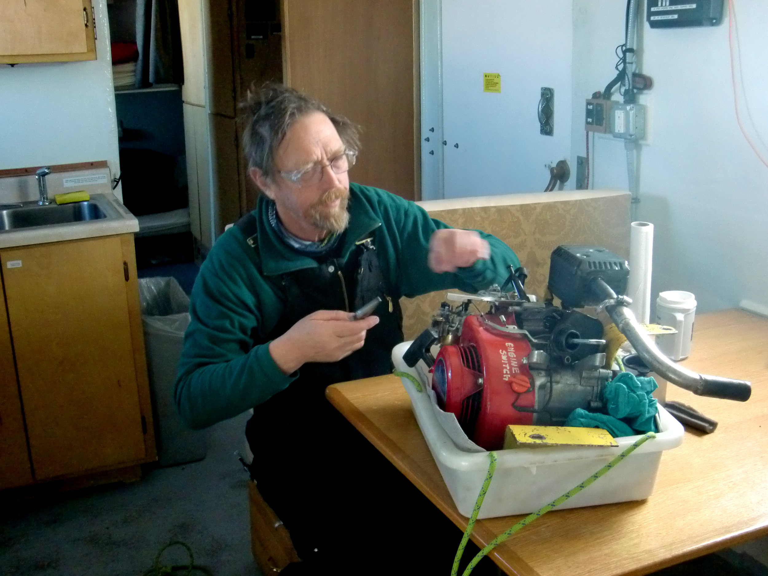 Is Robin Davies making repairs or dinner? Either way, Summit Station can't come too fast! Photo: Shep Vail (2012 GrIT)