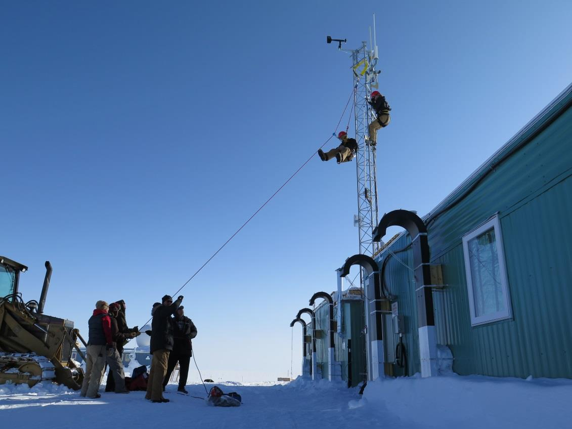"""The Summit Station Emergency Response Team """"rescues"""" NOAA technician Lance Roth during a safety drill. Photo: Ken Keenan"""
