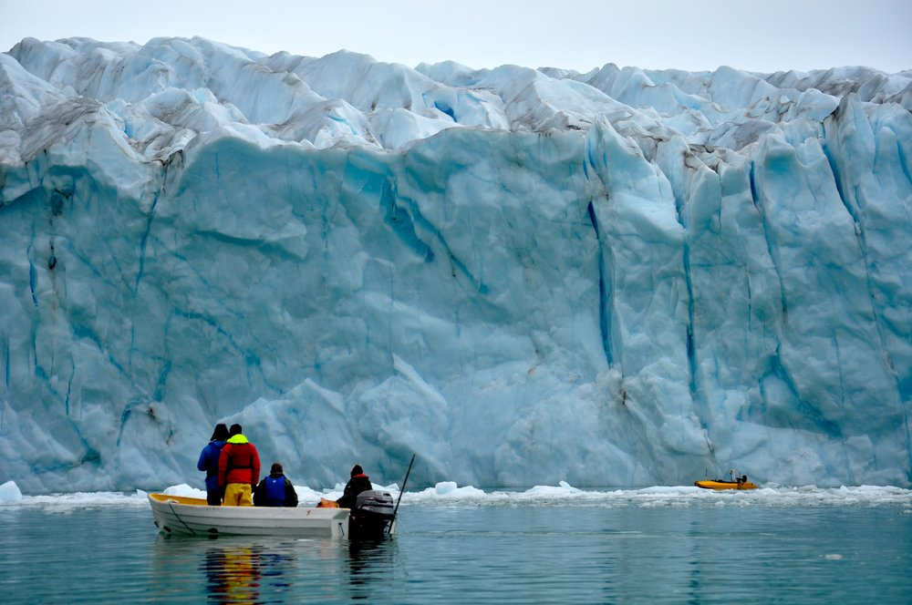 Hanu Singh (WHOI), Clark Richards (WHOI), and Ken Mankoff (WHOI) maneuver the JETYAK through small icebergs as it completes a transect near the Sarqardliup Glacier terminus. Photo: Laura Stevens