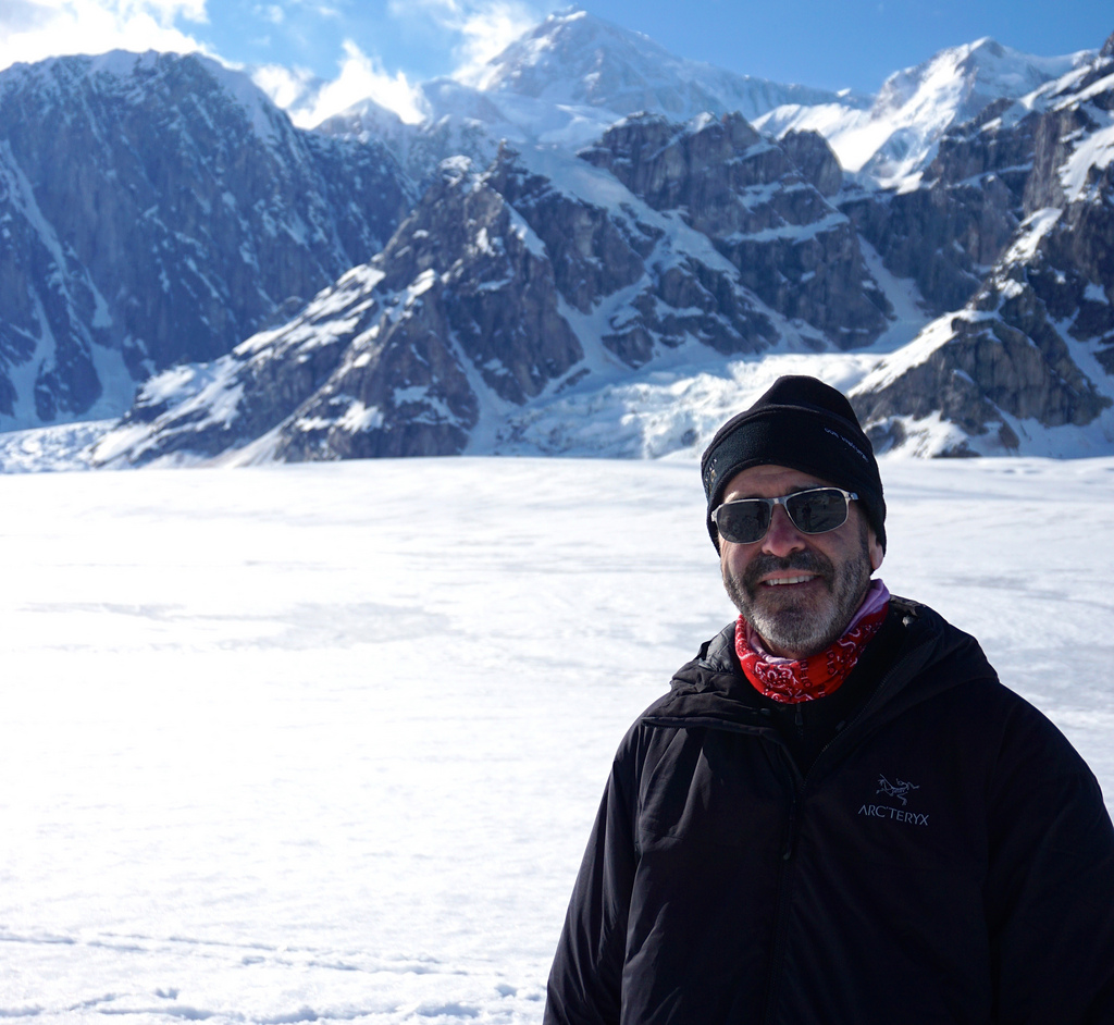 Miles O'Brien poses for a moment on the Ruth Glacier.