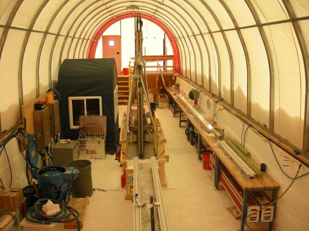 Inside the drill tent showing the control room (left), drill (center) and ice core processing area (right).