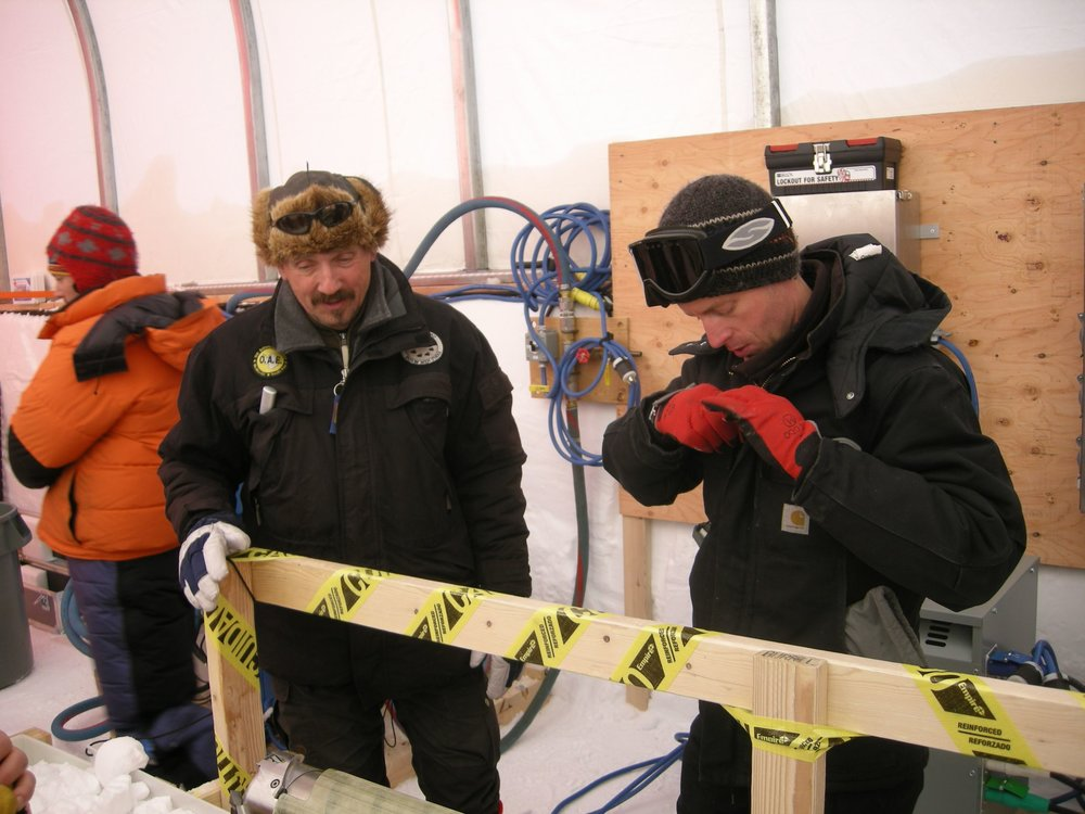 Jay Johnson, drilling engineer for Ice Drilling Design and Operations group at the University of Wisconsin-Madison (right) discussing the drill operations with Steffen Bo Hansen from the Centre for Ice and Climate, Copenhagen.