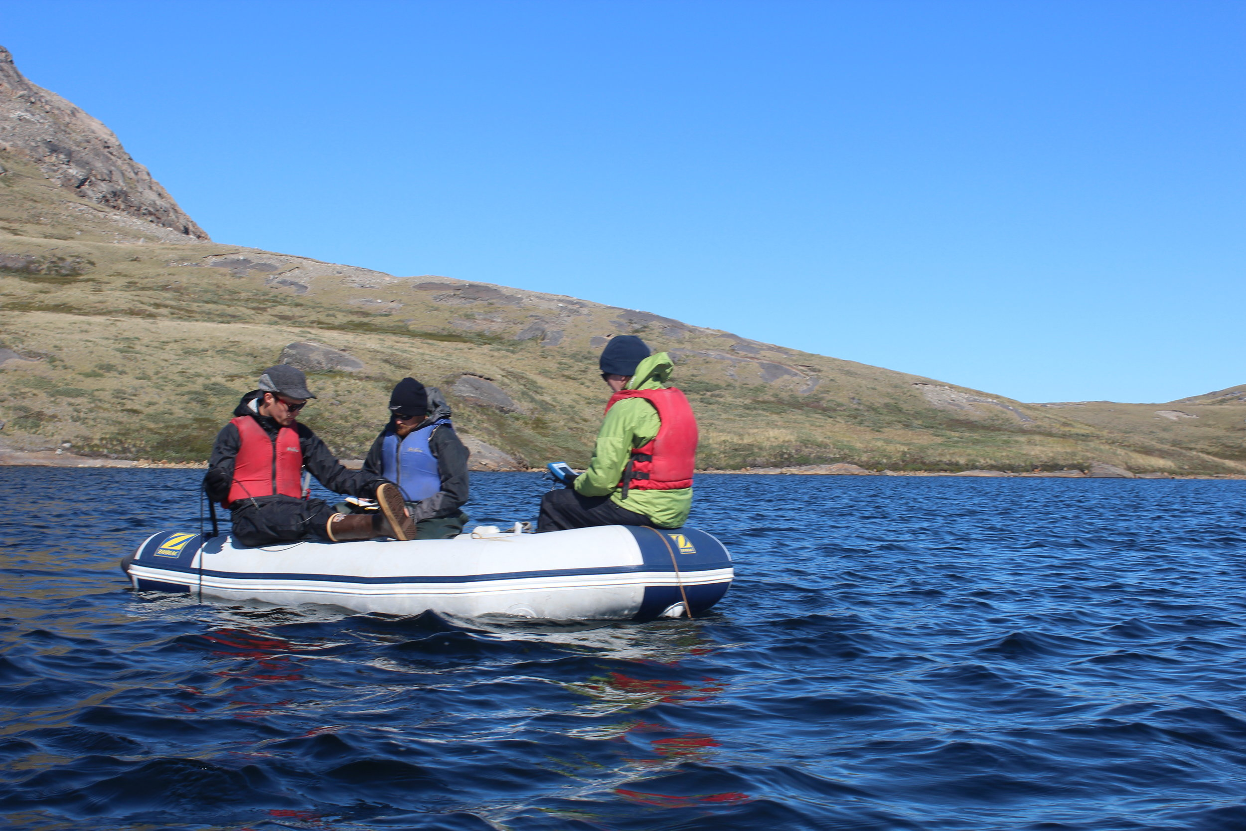 Saros and her team measuring the temperature of one of the lakes. Photo: Emily Rice