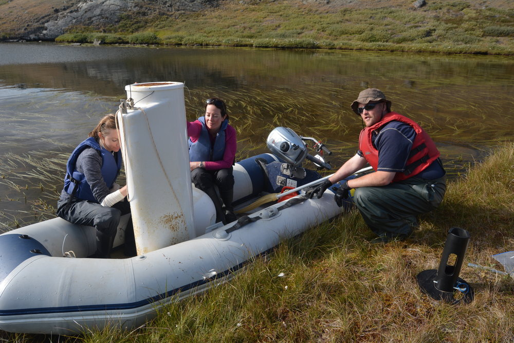 Here the team retrieves the 80-pound sediment traps from the experimental lake. Photo: Benjamin Burpee