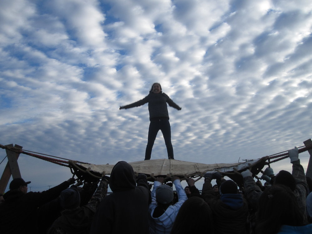 Making genuine connections with the local community is an important step in building the relationships and trust needed to get answers to the researchers' questions. Here graduate student Charlene Apok participates in a blanket toss last summer. Photo: Sarah Huang