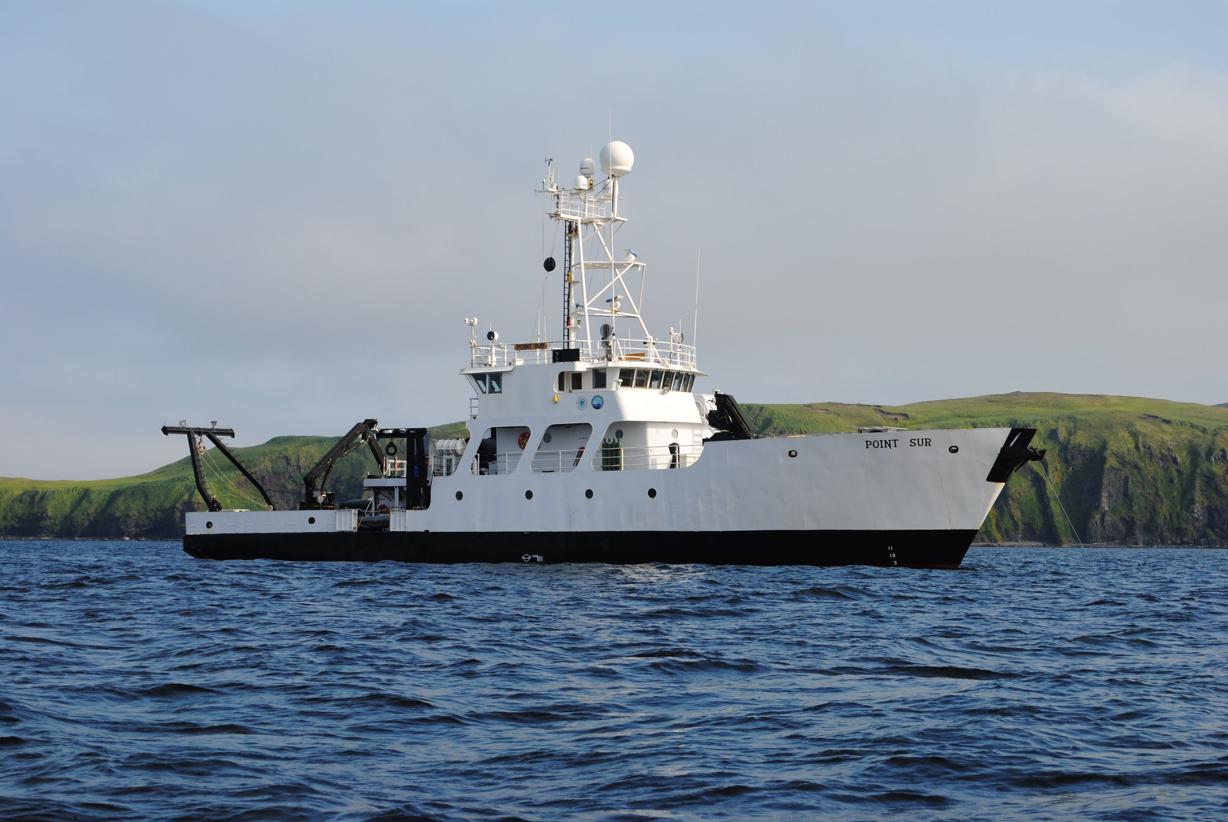 A team of scientists travel aboard the vessel R/V Point Sur during a research expedition to the Aleutian Islands, Alaska in July 2014. Photo: Kim Powell