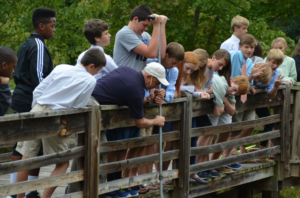 Martin and students at Greensboro Day School taking sediment cores in local sediment detention pond. Photo courtesy Tim Martin