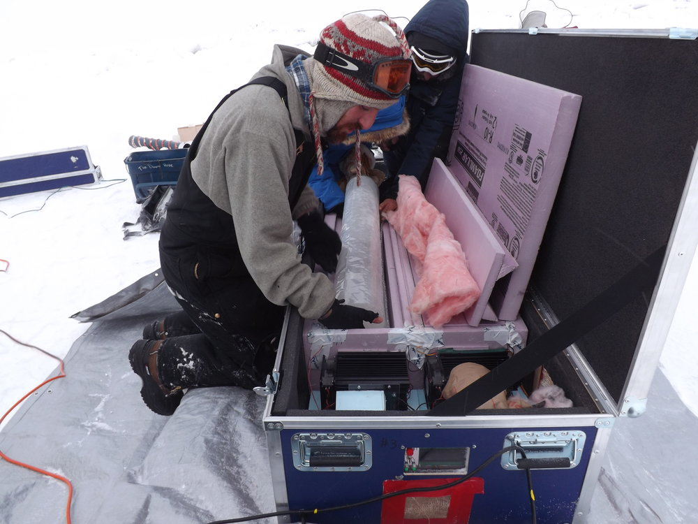 A freshly cut ice core goes into the ICE-MITT box.