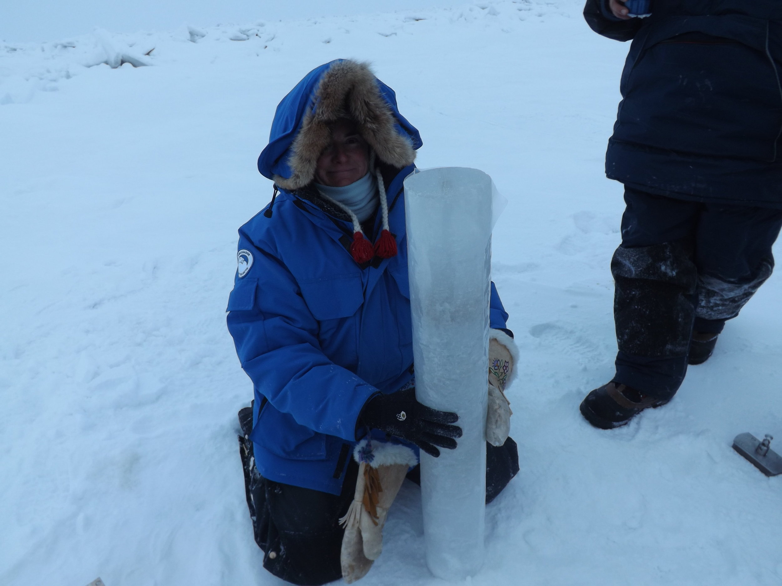 Dr. Rachel Obbard loving her unbroken, meter-long ice core.